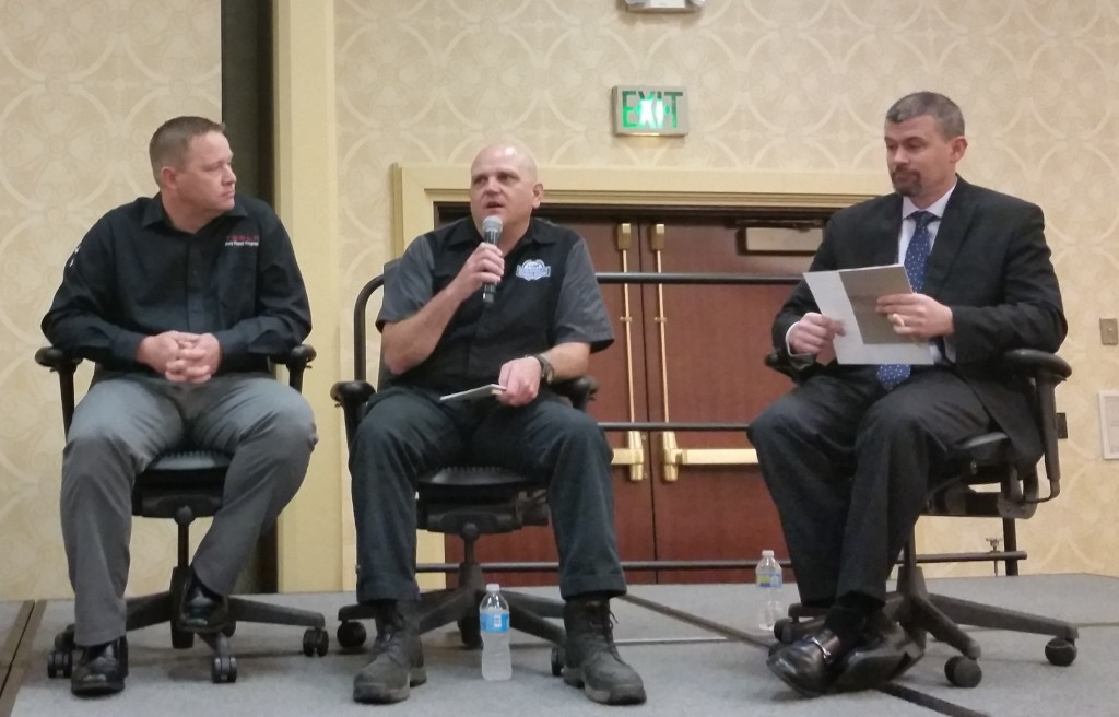 2016 SCRS Repairer Roundtable panelist Jason Bartanen, I-CAR industry technical relations director (there to represent Jaguar Land Rover's program), center, speaks while Tesla body repair program technical manager Kelly Logan, left, and SCRS Chairman Andy Dingman listen. (John Huetter/Repairer Driven News)