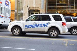 A Progressive Insurance vehicle drives along West 57th street in Manhattan on  June 2, 2011. (wdstock/iStock)