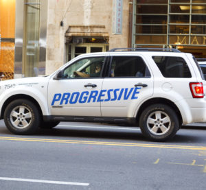 A Progressive Insurance vehicle drives along West 57th street in Manhattan on  June 2, 2011. (wdstock/iStock)