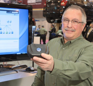 Chrysler dealer technical operations and global service director Al Motta displays the wiTECH in 2009. (Provided by FCA)