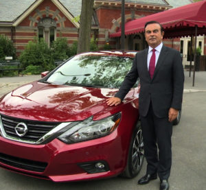 Nissan Chairman and CEO Carlos Ghosn poses with the mid-cyle-refreshed  2016 Nissan Altima. (Provided by Nissan)