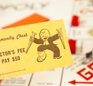 "A Community Chest card from a 1960s-era ""Monopoly"" game. In a sign that health care costs were apparently always high, $50 in doctor's fees today was $864 in 1936, when the game was patented, and worth $405 in 1960. (Pamela Moore/iStock)"