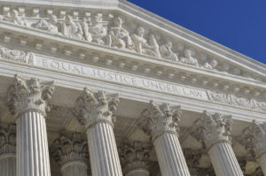 The sculpted exterior of the U.S. Supreme Court. (bbourdages/iStock)