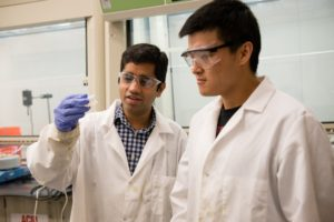 Clemson automotive engineering assistant professor Srikanth Pilla works with a graduate student. (Provided by Clemson)