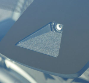 An example of an advanced driver assistance systems device mounted behind a windshield. (Provided by Thatcham)