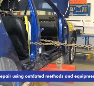 This screenshot from Volkswagen Ireland video shows a Volkswagen Passat B6 being repaired with outdated methods. (Screenshot from VW Ireland video on YouTube, www.youtube.com)