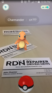 """Photo illustration: We put out some cards to hype ourselves while demonstrating the augmented reality of """"Pokémon GO."""" (Screenshot from """"Pokémon GO"""" app, image arranged by John Huetter/Repairer Driven News)"""