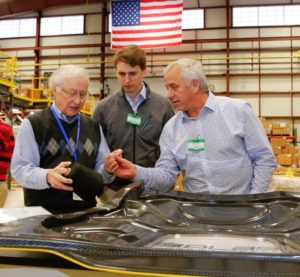 Cycling legend Greg LeMond, right, is pictured next to a carbon-fiber component at an unspecified location, likely Oak Ridge National Laboratory. (Provided by LeMond Composites)