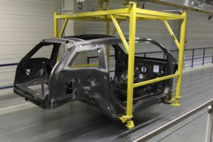 A BMW i3 carbon-fiber body can be seen at a Leipzig, Germany, plant in this photo provided in 2013. (Provided by BMW)