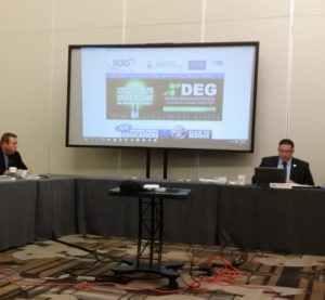 A promotion for the Database Enhancement Gateway can be seen in the background during the Society of Collision Repair Specialists open board meeting on Aug. 9, 2016, in Anaheim, Calif. (John Huetter/Repairer Driven News)