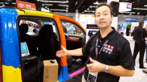 "Eric Mendoza, of Toyota Collision Repair & Refinish Training, demonstrates at NACE 2016 that the calibration of Occupant Classification System (OCS) sensors can be affected when a Toyota vehicle is involved in a collision while ""parked and unattended."" Mendoza states that Toyota OCS systems should be checked and calibrated in accordance with each vehicle's specific repair manual. (Screenshot from RDN/Toyota CRRT video on Repairer Driven News YouTube channel.)"