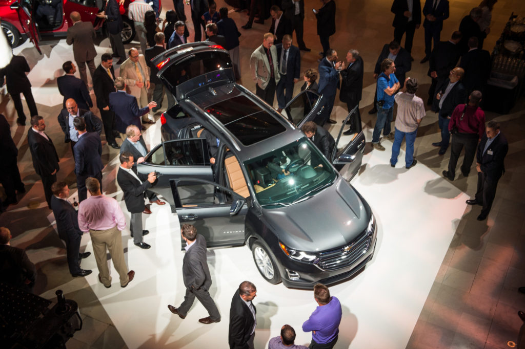 Media examine the 2018 Chevrolet Equinox on Sept. 22, 2016 in Chicago. (Brian Kersey for Chevrolet/Copyright General Motors)