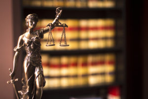 Justice is blind, but she still gets a lot of reading done. (edwardolive/iStock)