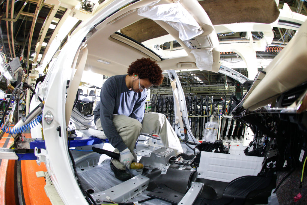 An employee works on a Toyota Avalon at Toyota's Georgetown, Ky., plant.