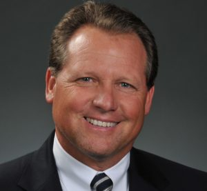 "Bridgestone America retail operations President and Chairman Stuart ""Stu"" Crum has been hired as Service King's Chief Operations Officer. (Provided by Service King)"