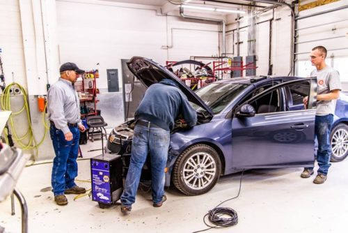 Owner Bruce Halcro, left, is seen in his Helena, Mont., body shop Capital Collision Center.  (Provided by Capital Collision Center)