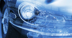 This is a connected car, as you can tell from the cool meaningless graphics emanating from it. (Sergey Nivens/iStock)