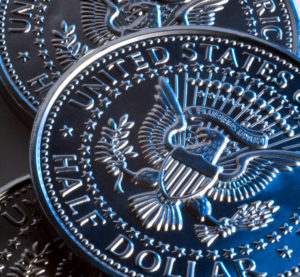 Half dollar coins are shown. (SteveAllenPhoto/iStock)