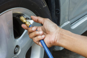 Analysis of a California auto repair bill signed into law Friday references situations where something as mundane as changing a tire or spark plug can require training. (iJacky/iStock)