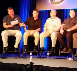 From left, Gary Wano of G.W. and Sons asks a question while Shawn Hart of Audi, Mike Kukavica of Porsche and Rick Miller of Jaguar Land Rover listen during an OEM trainer forum on Nov. 3, 2016, at SEMA. (John Huetter/Repairer Driven News)
