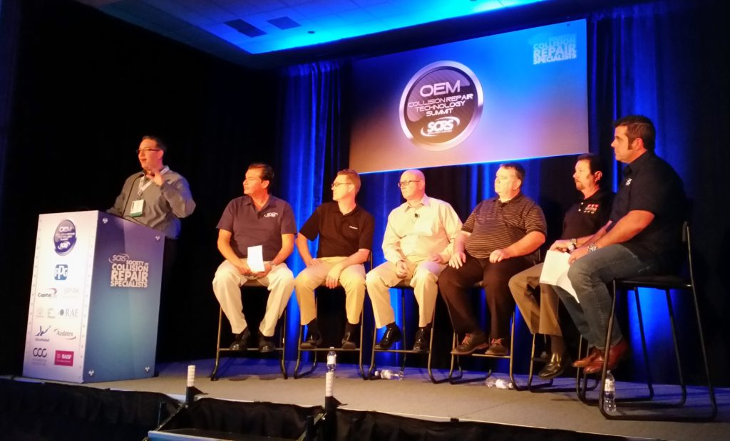 From left, Aaron Schulenburg of SCRS introduces the panel: Gary Wano of G.W. and Sons, Shawn Hart of Audi, Mike Kukavica of Porsche, Rick Miller of Jaguar Land Rover, James Meyer of Toyota and Barry Dorn of Dorn's Body and Paint, during the an OEM trainer forum on Nov. 3, 2016, at SEMA. (John Huetter/Repairer Driven News)